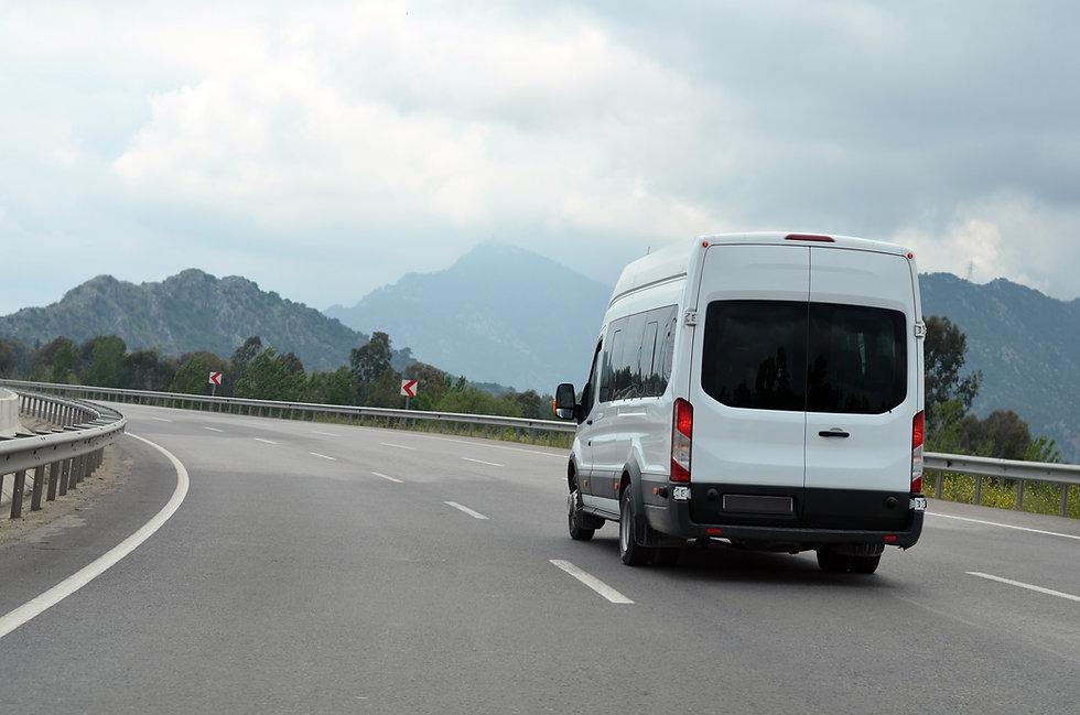minibus or minicoach on mountain highway