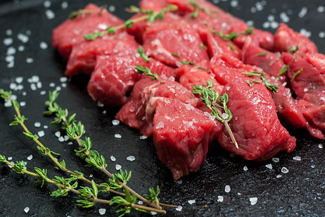ellie bell photography, food photography, steak, beef, stewing steak, raw meat, meat, red, red meat, sea salt, herbs, rosemary