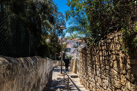 ellie bell photography, albufeira, portugal, algarve, coast, town, portugese, europe, walkway, path, plants, summer, warm, man