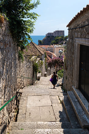 ellie bell photography, dubrovnik, croatia, europe, view, castle, coast, sea, path, steps, flowers, plants, woman, summer, walk