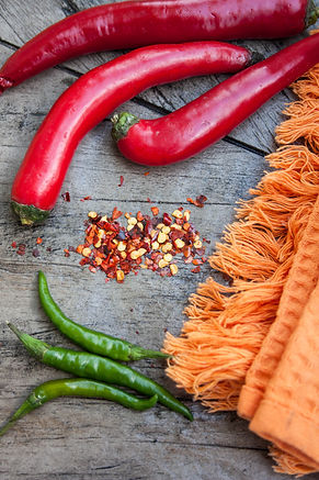 ellie bell photography, food photography, chilli, red, green, orange, dried chilli, teatowel, orange
