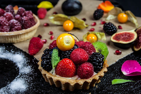 ellie bell photography, food photography, fruit, fruit tart, dessert, blackcurrant, raspberry, strawberry, kiwi, fig, pomegranate seeds, sweet