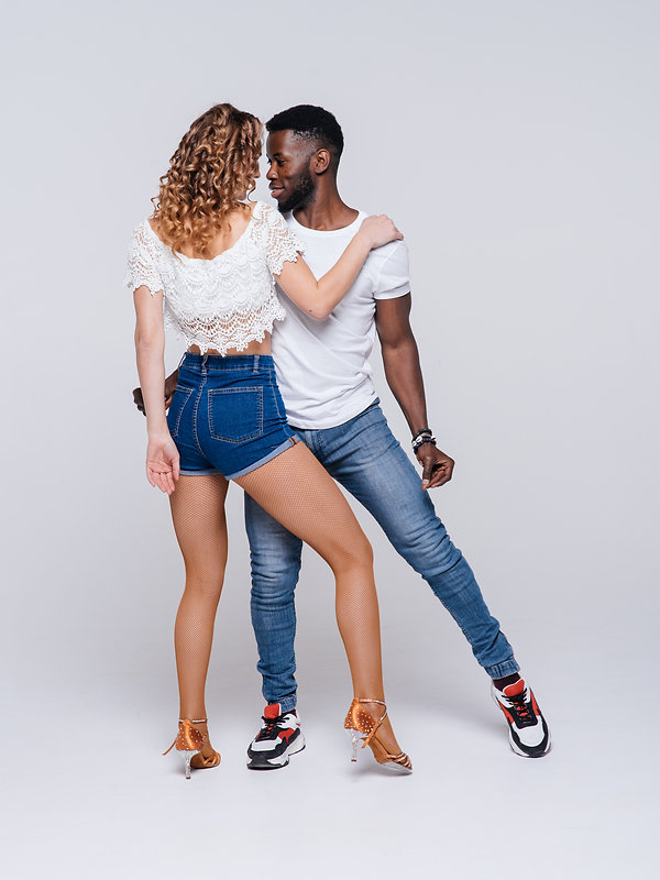 Couple dancers posing over white backgro