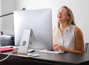 woman-in-white-tank-top-using-macbook-ai