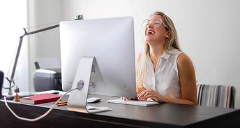 woman-in-white-tank-top-using-macbook-ai