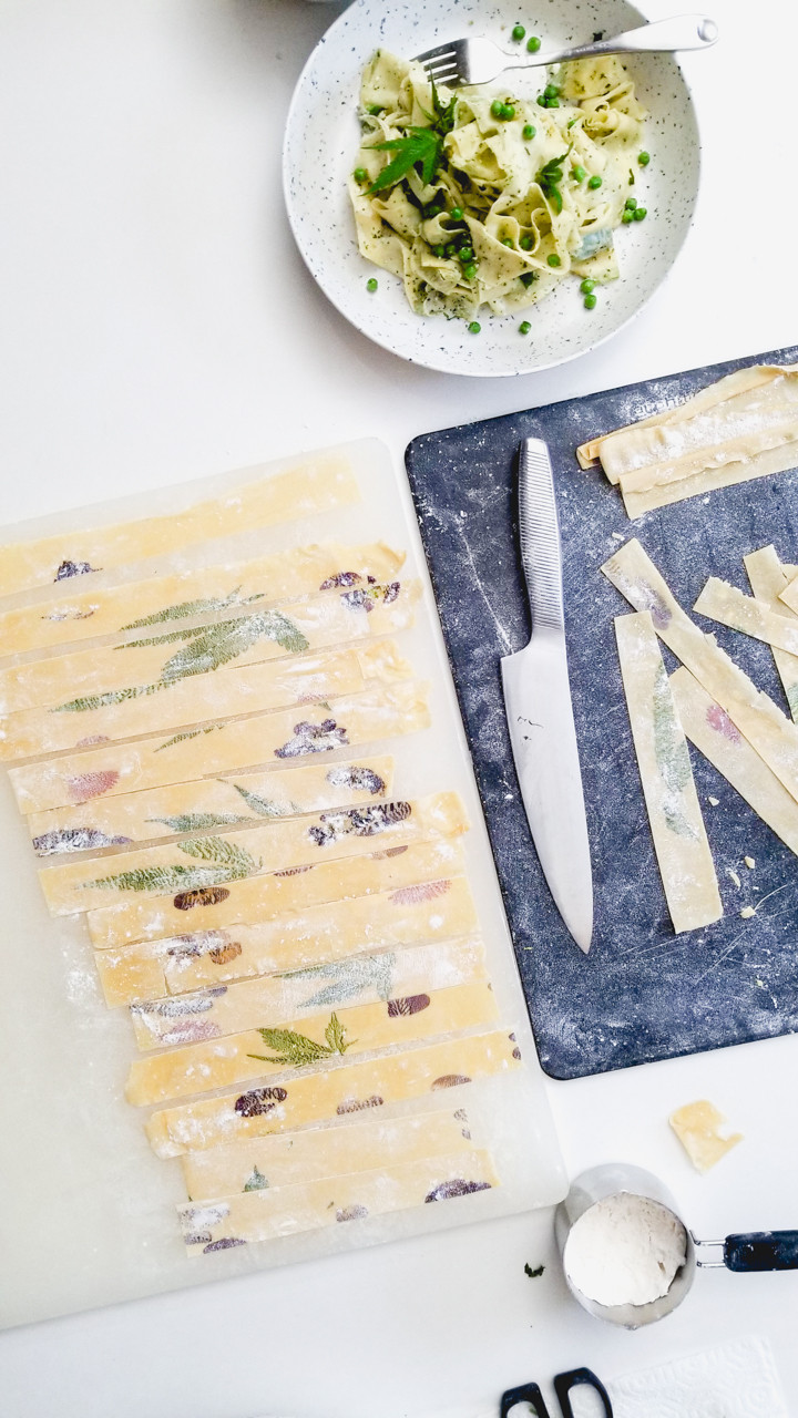 cannabis pasta with pressed leaves and flowers