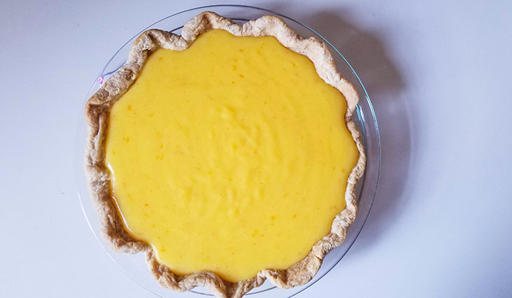 orange curd poured into pie shell