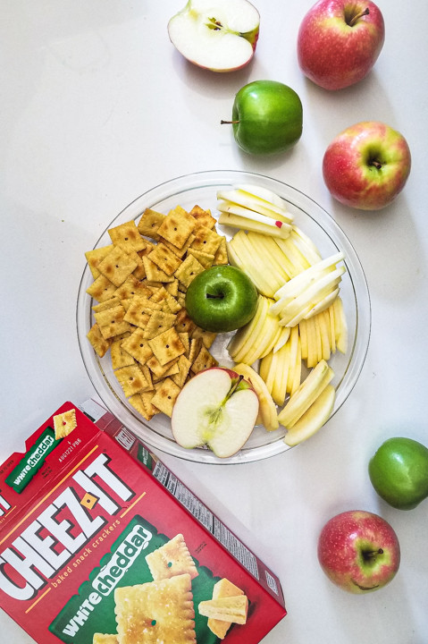 cheez-it crackers and sliced apples in a pie pan