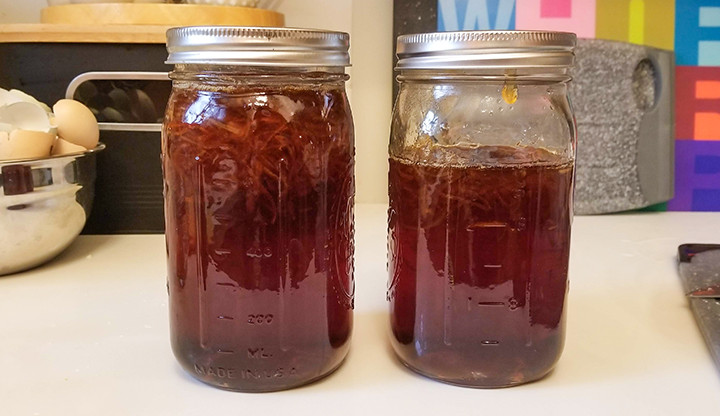 quart mason jars filled with marmalade