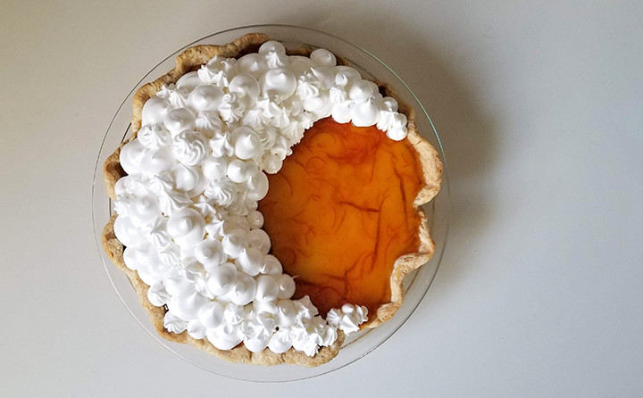 white meringue on orange pie