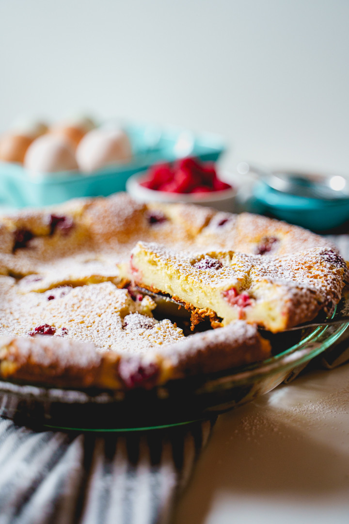 slice of cherry clafoutis lifted out of pan