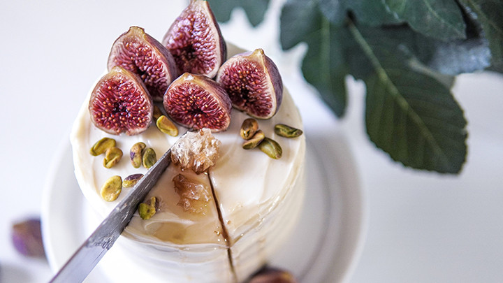 sliced fresh figs on top of a cake
