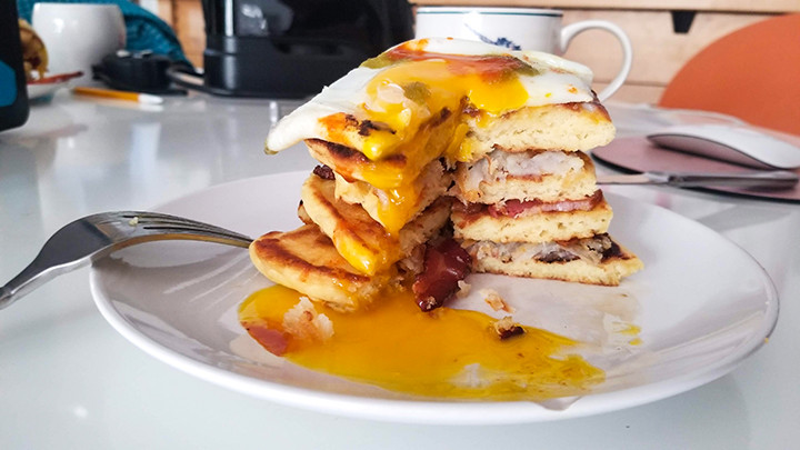pancake stack with fried egg on top