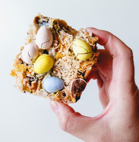 magic seven layer blondie bar with pretzels, corn flakes cereal, shredded coconut and easter egg candy