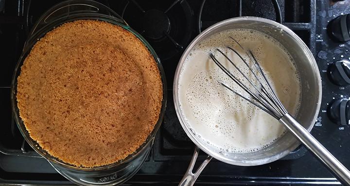 banana milk on stove and empty vanilla wafer pie crust