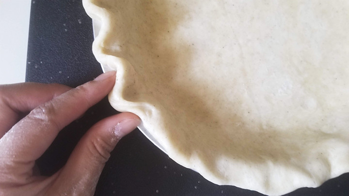 fingers crimping pie crust