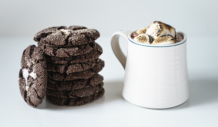 hot cocoa cookie with cup of hot chocolate and marshmallows