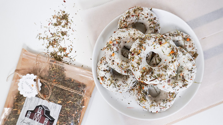 plate of donuts next to bag of dried herbs