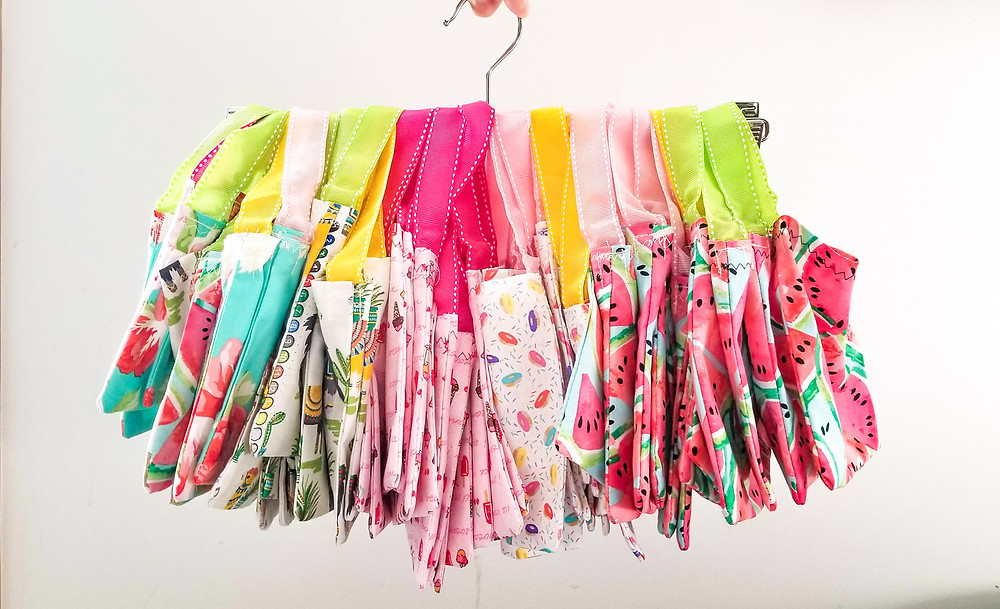small fabric bags on a hanger