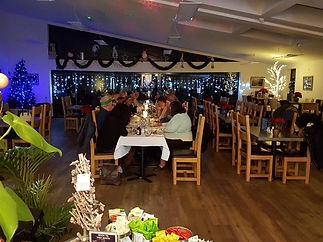 Christmas table with people 2017.JPG