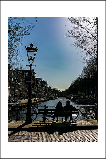 Couple overlooking the canal in Amsterdam - The Netherlands