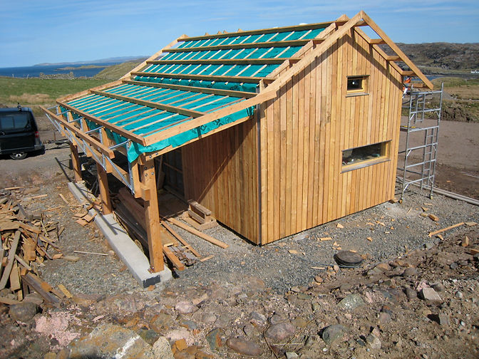 insulated garage studio built using native larch timber and ecological insulation near Lochinver, Highlands
