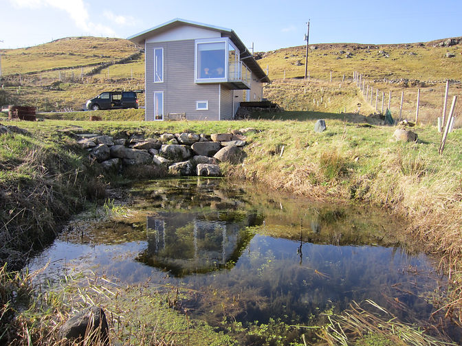 timber eco-home near Lochinver with rewilded garden and pond