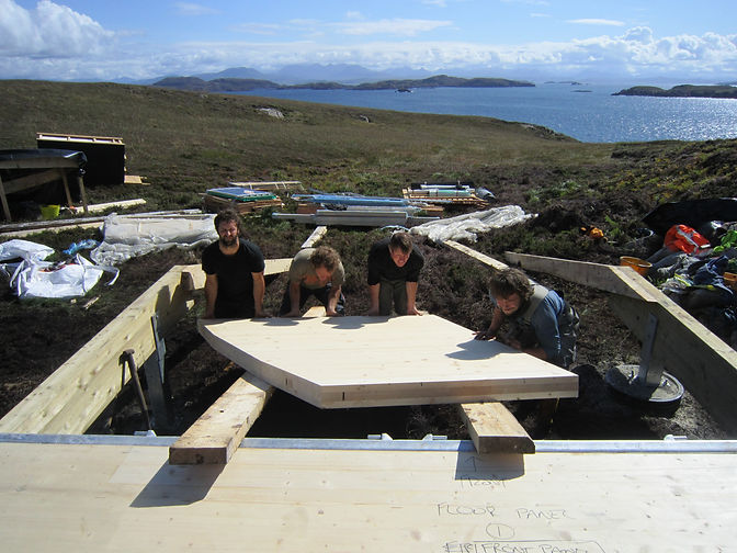 the North Woods specialist construction team lifting cross-laminated timber panels for an off-grid luxury cabin pod near Achiltibuie