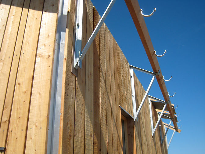 detail of native larch timber cladding on an insulated garage