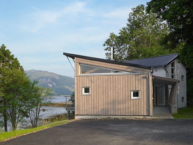 a luxury architectural timber eco house with sustainable design in the Scottish Highlands