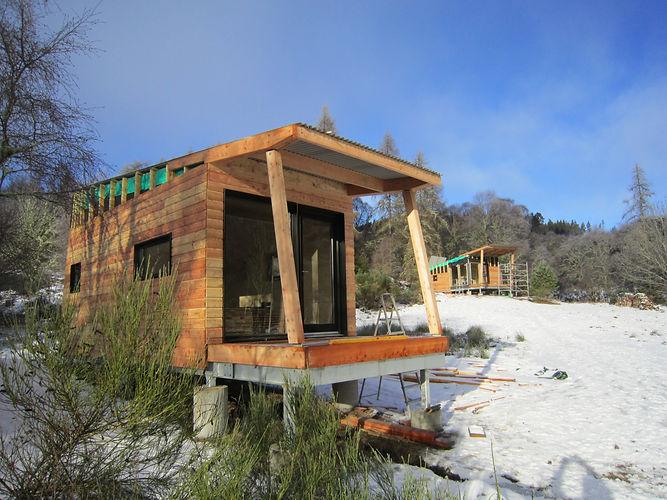 custom-designed architectural ecological pod cabins near Lairg, Scotland
