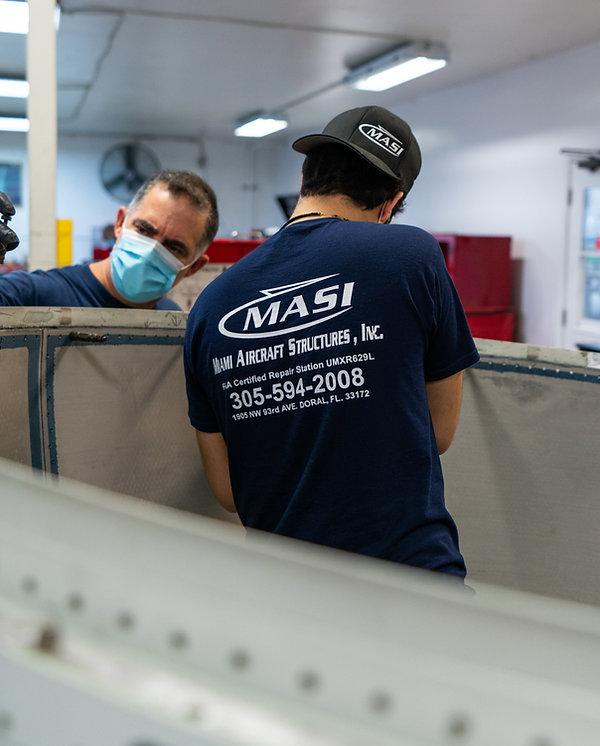 MASI Employee repairing an aircraft unit