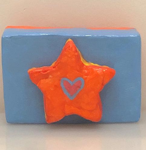 """ORANGE STAR WITH BLUE HEART"""