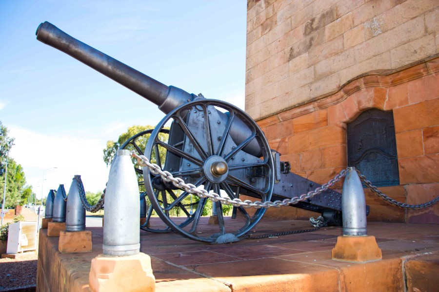 The Long Cecil gun that was designed and manufactured in the workshops of De Beers during the siege is surrounded by shells from the Boer Long Tom.