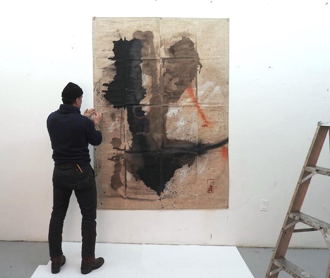 Artist with Tarp Painting