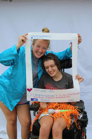 Camper in wheelchair and camp counselor