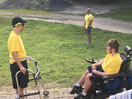 Campers with disabilities relaxing outside