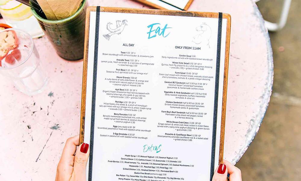 person holding a restaurant menu