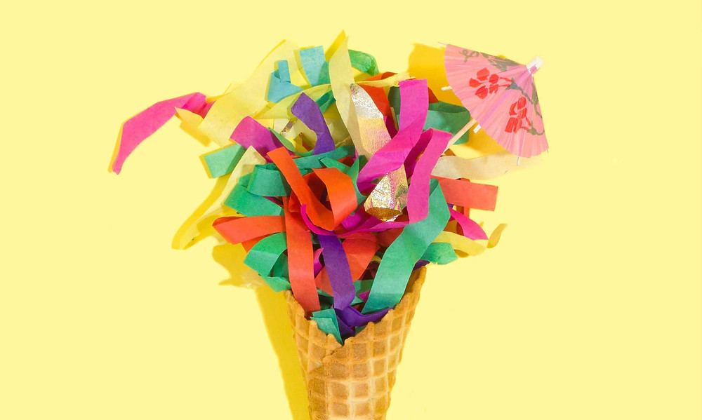 colourful ice cream on yellow background