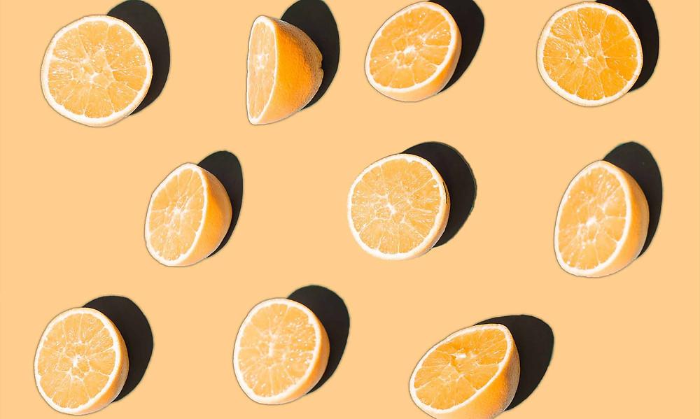 oranges slice in half on orange background