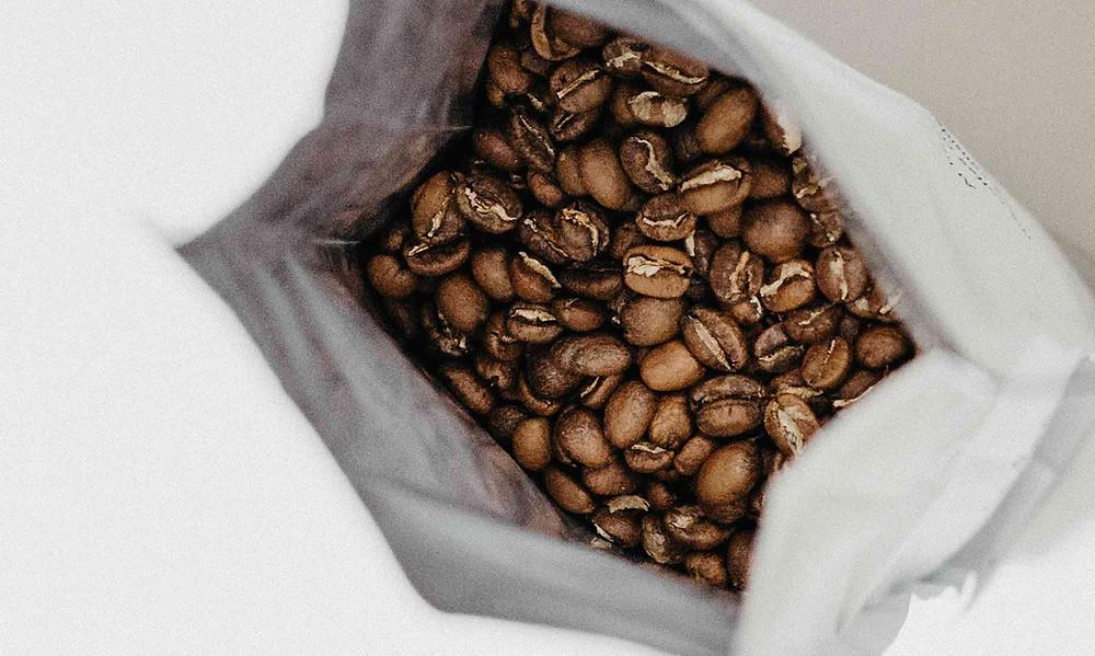 coffee beans in a white bag