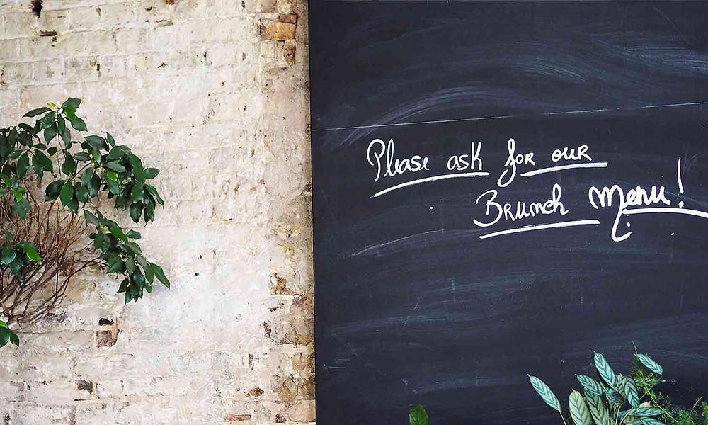 restaurant chalkboard mentioning brunch menu