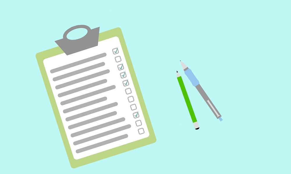 checklist clipboard and pens