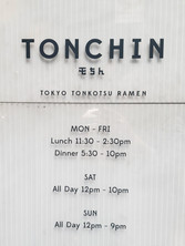 Sign displaying a restaurant's hours