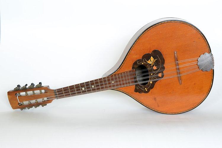 Brown vintage old mandoline with strings