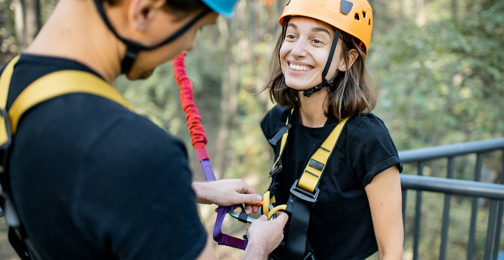 Woman trusts man to clip her bungy cord safely