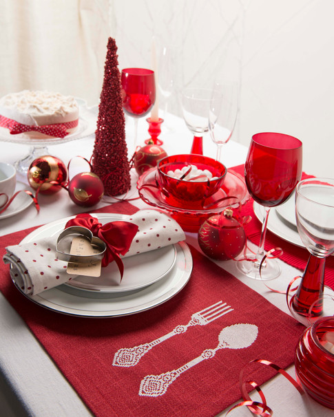 christmas table with red table mats and glasses