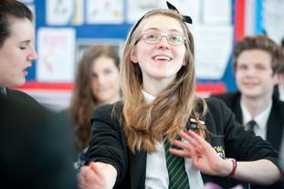 happy schoolgirl in lesson