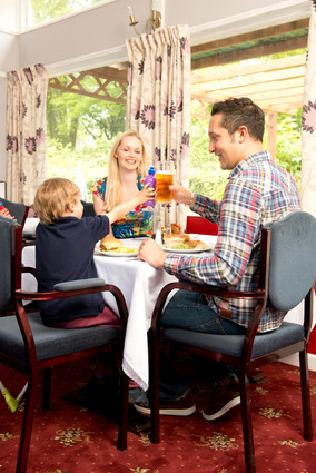 family in resturant of holiday park