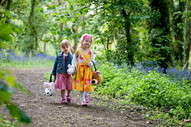 young girls walking in the woods at a holiday park in cornwall